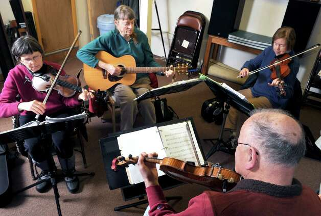 Left to right, Dian Ryan, Nancy Crowther,  Jeanne Mathewson and Frank Tetler take part in a Aussie band jam night at Old Songs on Wednesday Feb. 25, 2015 in Voorheesville, N.Y. (Michael P. Farrell/Times Union) Photo: Michael P. Farrell / 00030711A