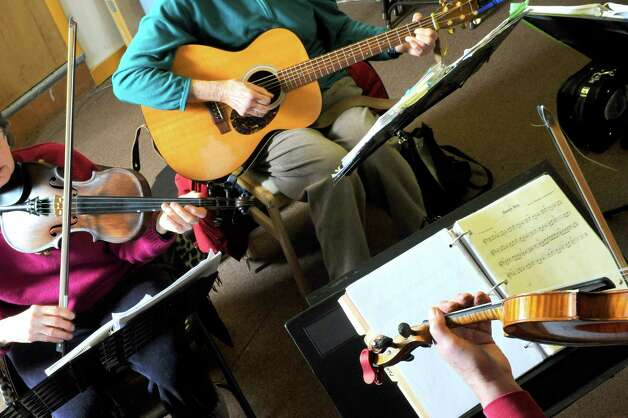 Left to right, Dian Ryan, Nancy Crowther and Frank Tetler take part in a Aussie band jam night at Old Songs on Wednesday Feb. 25, 2015 in Voorheesville, N.Y. (Michael P. Farrell/Times Union) Photo: Michael P. Farrell / 00030711A