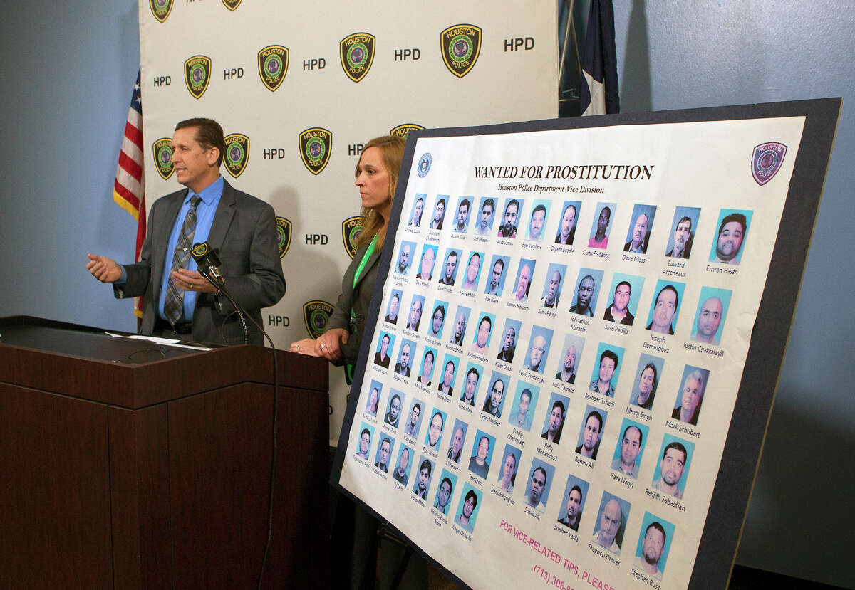 Capt. Dan Harris head of the HPD Vice Division, left, and Lt. Cathy Richards of the HPD Vice Division, right, speak to the media after a sting operation, Wednesday, March 4, 2015, in Houston. More than 60 men have been snared in a sting operation as they allegedly tried to pay for sex earlier this year at a bogus modeling studio police opened in the Houston area.