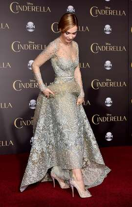 "Actress Lily James arrives at the premiere of Disney's ""Cinderella"" at the El Capitan Theatre on March 1, 2015 in Los Angeles, California.  (Photo by Kevin Winter/Getty Images)"
