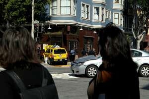 Uber and taxi collide in S.F., sending cab into Mission bar - Photo