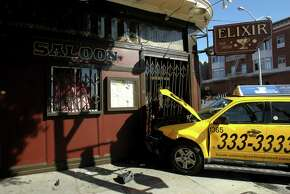 The scene of a collision between a four-door silver Mazda 3 and a yellow cab, which then crashed into the Elixir bar at the corner of 16th and Guerrero Street, Wednesday, March 4, 2015, in San Francisco, Calif.