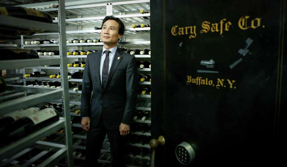 "Yoon Ha, master sommelier and wine director at Benu in S.F., in the restaurant's wine room: ""I think there is a shortage of mentors"" for new sommeliers, he says. Photo: Russell Yip / The Chronicle / ONLINE_YES"
