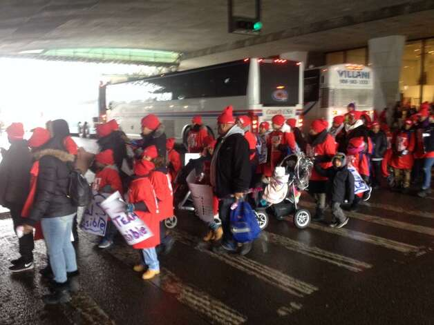 Buses unload children on Madison Avenue for Wdnesday's pro charter school rally at the Capitol in Albany. (John Carl D'Annibale / Times Union)
