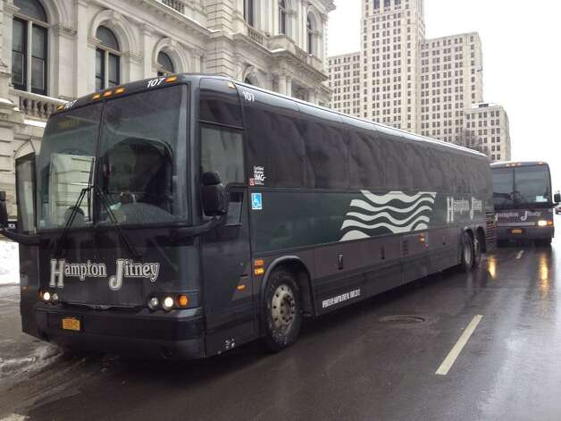 Buses begin arriving at the Capitol for Wednesday's pro charter school rally in Albany. (John Carl D'Annibale / Times Union)