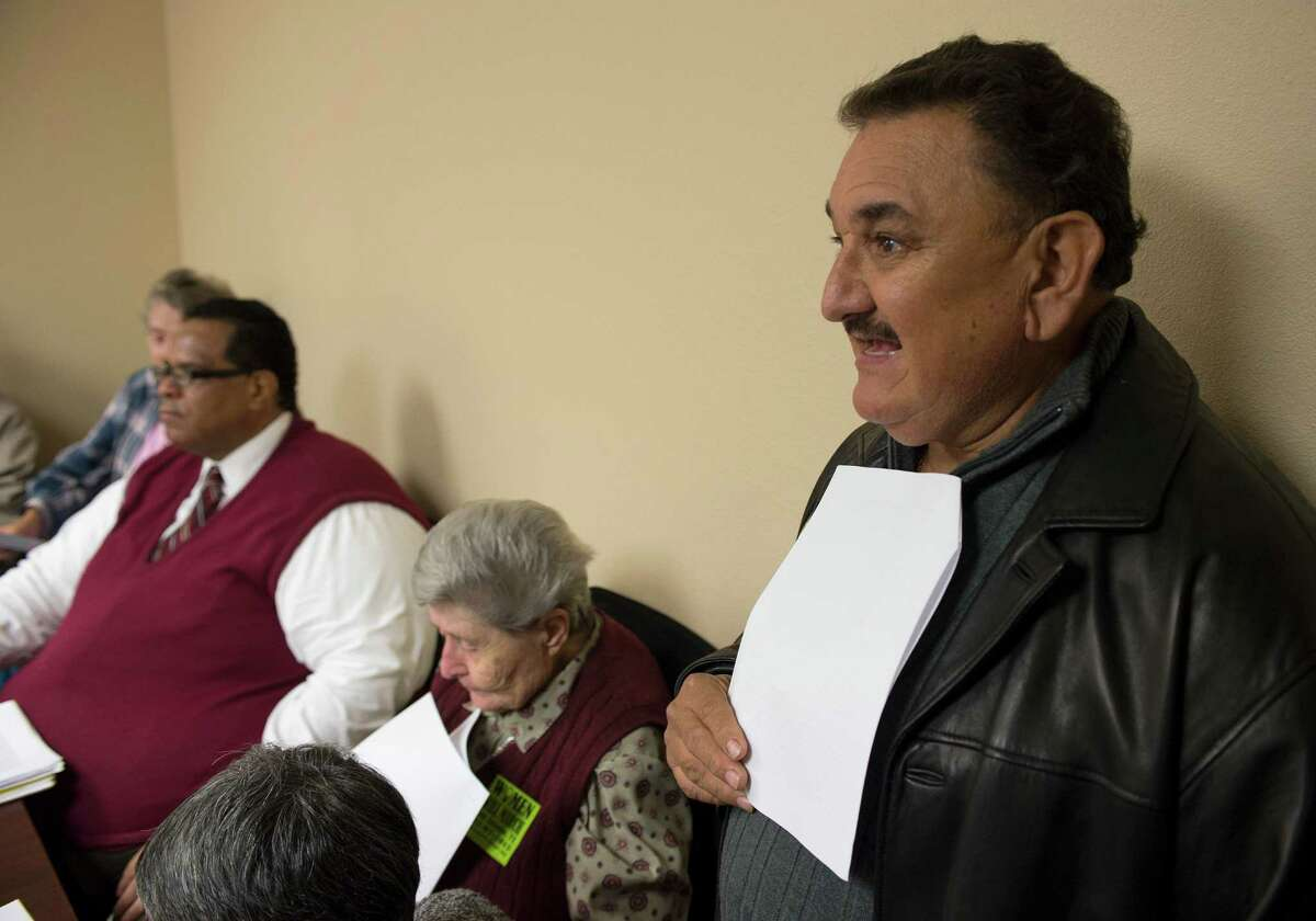Taxi cab company owner Robert Gonzales, right, speaks during an assembly held to oppose new regulations crafted by the city to persuade ride sharing services, such as Uber and Lyft, to continue operating in San Antonio, Wednesday, March 4, 2015, at the City Council District 2 Field Office on East Commerce in San Antonio.