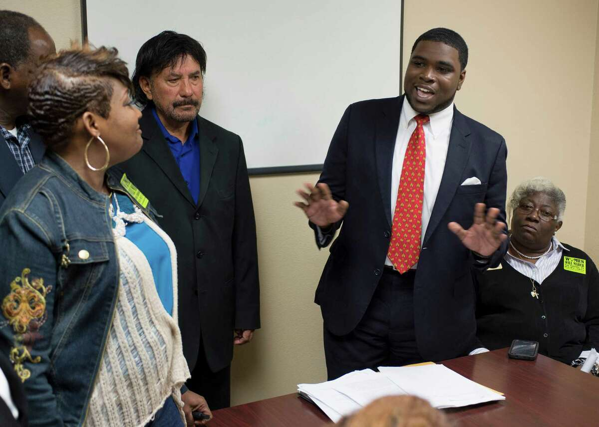 Akeem Brown, City Council District 2 Director of Communications and Policy, speaks to attendees during an assembly held to oppose new regulations crafted by the city to persuade ride sharing services, such as Uber and Lyft, to continue operating in San Antonio, Wednesday, March 4, 2015, at the City Council District 2 Field Office on East Commerce in San Antonio.