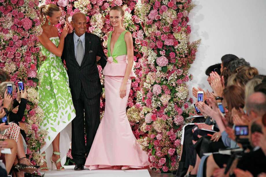 Oscar de la Renta takes a bow at the last fashion show at which he would appear. He died of cancer in late 2014. Photo: Courtesy Of Oscar De La Renta / ONLINE_YES