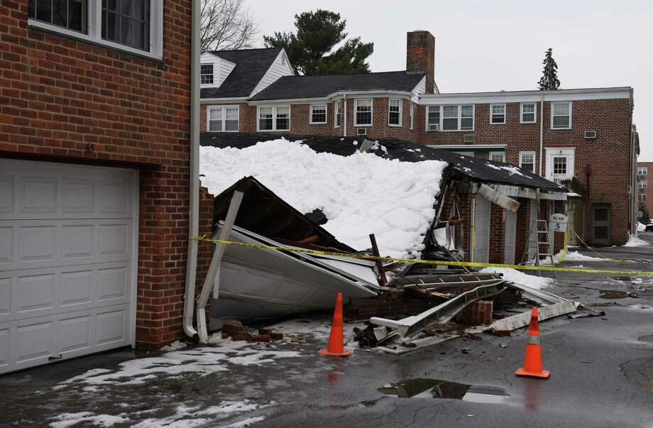 A garage collapsed due to the weight of snow atop the structure in the Putnam Park Apartments complex in Greenwich, Conn. on Wednesday, March 4, 2015.  Nobody was injured in the collapse, but four vehicles were damaged and stuck inside the garage. Photo: Tyler Sizemore / Greenwich Time