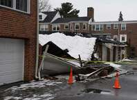 A garage collapsed due to the weight of snow atop the structure in the Putnam Park Apartments complex in Greenwich, Conn. on Wednesday, March 4, 2015.  Nobody was injured in the collapse, but two vehicles were damaged and stuck inside the garage.