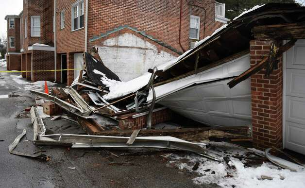 Snow causes garage roof collapse cars damaged newstimes for Garage ww auto