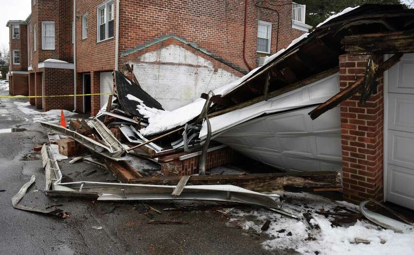 A garage collapsed due to the weight of snow atop the structure in the Putnam Park Apartments complex in Greenwich, Conn. on Wednesday, March 4, 2015. Nobody was injured in the collapse, butfourvehicles were damaged and stuck inside the garage.