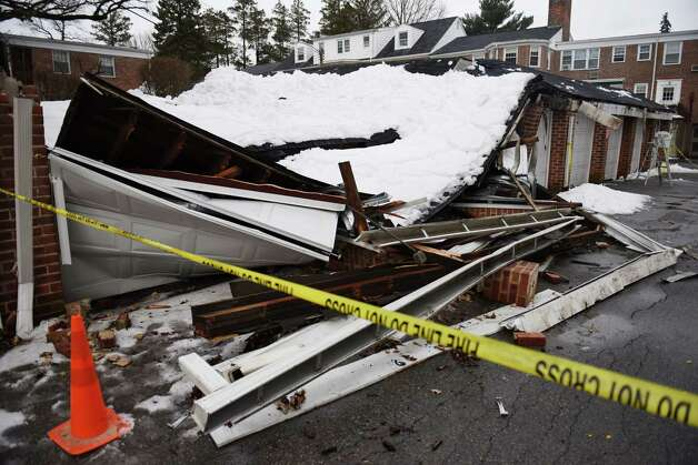 Snow causes garage roof collapse cars damaged greenwichtime for Garage ww auto