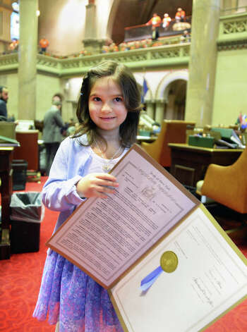 Six-year-old Emma Detlefsen of Berne holds an Assembly Resolution honoring her in the Assembly Chamber Wednesday March 4, 2015 in Albany, NY.  (John Carl D'Annibale / Times Union) Photo: John Carl D'Annibale, Albany Times Union / 10030864A