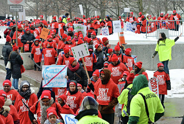 Children are lead across the Empire State Plaza on their way to the pro charter rally at the Capitol Wednesday March 4, 2015 in Albany, NY.  (John Carl D'Annibale / Times Union) Photo: John Carl D'Annibale, Albany Times Union / 00030815A