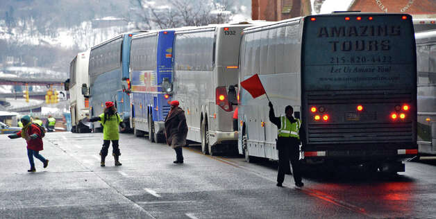 Buses queue up on Madison Ave. bringing student, parents and educators to the pro charter rally at the Capitol Wednesday March 4, 2015 in Albany, NY.  (John Carl D'Annibale / Times Union) Photo: John Carl D'Annibale, Albany Times Union / 00030815A