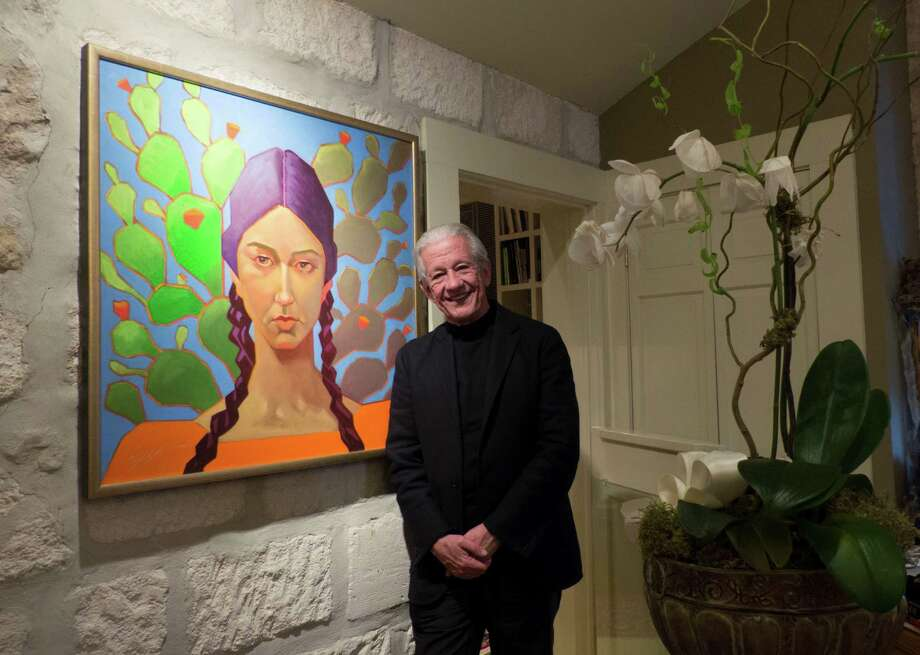 Lionel Sosa, Hispanic advertising pioneer and artist, stands by one of his paintings on Feb. 3, 2015. Photo: BILLY CALZADA, STAFF / San Antonio Express-News / © 2015 San Antonio Express-News