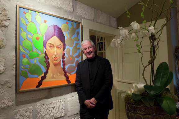 Lionel Sosa, Hispanic advertising pioneer and artist, stands by one of his paintings on Feb. 3, 2015.
