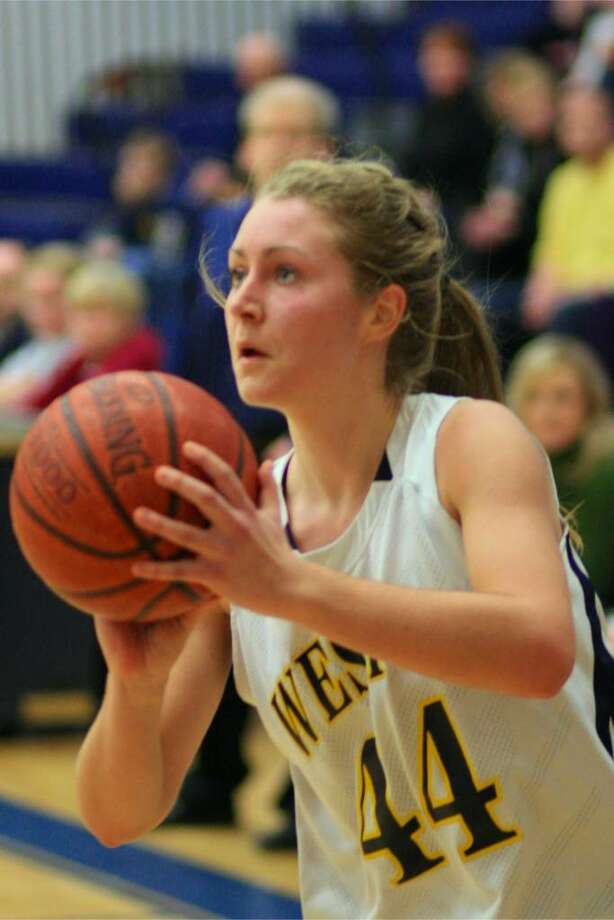 Weston senior captain Brittany Swanson prepares to shoot against New Fairfield on Tuesday. Swanson had 10 points in the Lady Trojans' 45-37 Class M playoff victory. Photo: Steve Stearns For The Westport News
