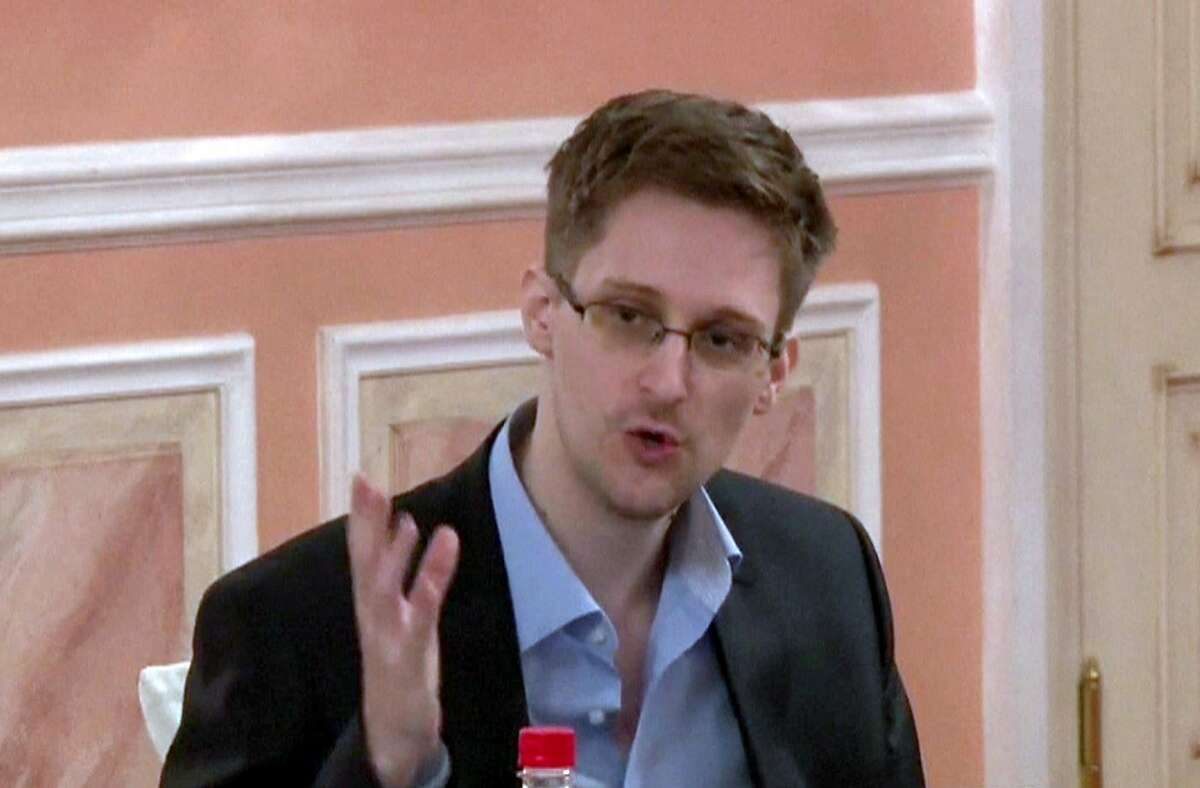 """An image grab taken from a video released by Wikileaks on October 12, 2013 shows US intelligence leaker Edward Snowden speaking during a dinner with US ex-intelligence workers and activists in Moscow on October 9, 2013. Edward Snowden, the fugitive whistleblower who has been given refuge in Russia, is willing to return to the United States if he is given a fair trial, Anatoly Kucherena, the Russian lawyer who represents the former National Security Agency contractor, said on March 3. AFP PHOTO / WIKILEAKS = RESTRICTED TO EDITORIAL USE - MANDATORY CREDIT """"AFP PHOTO / WIKILEAKS"""" - NO MARKETING NO ADVERTISING CAMPAIGNS - DISTRIBUTED AS A SERVICE TO CLIENTS =-/AFP/Getty Images"""