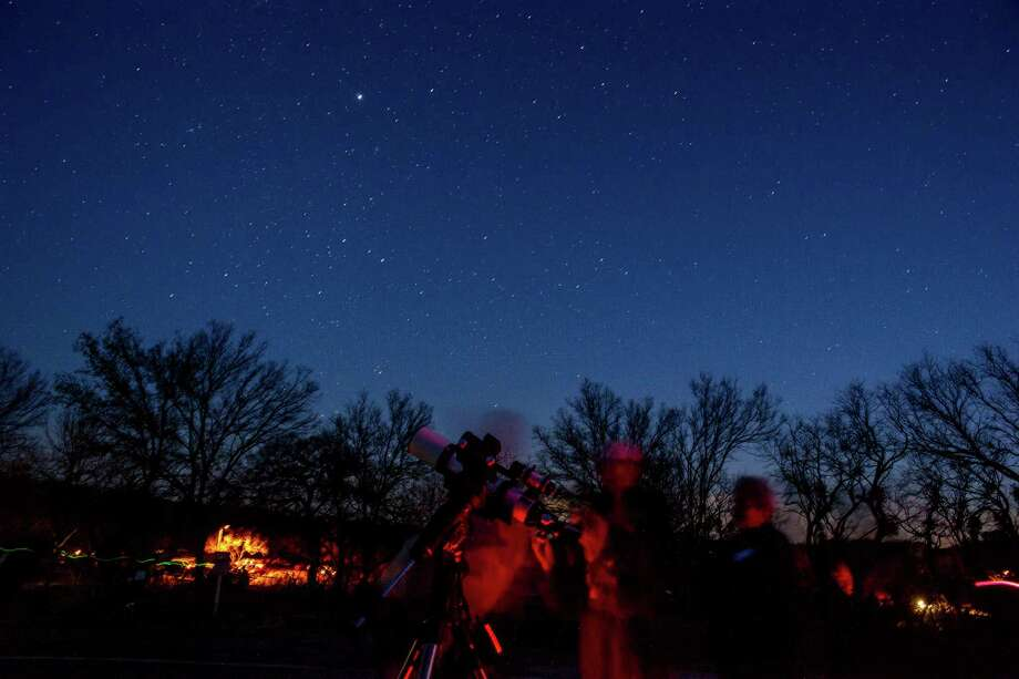 Amateur astronomers study the stars over Enchanted Rock State Park. during It was celebrating being named a Gold Tier Dark Skies park by the International Dark Skies Association. Photo: Joshua Trudell /For The Express-News