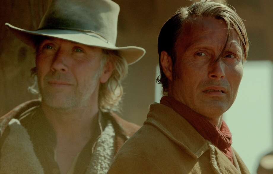 """Mikael Persbrandt (left) and Mads Mikkelsen in """"The Salvation."""" Photo: IFC Films / IFC Films"""