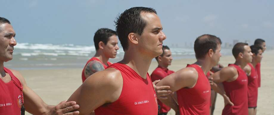 """Wagner Moura plays a Brazilian lifeguard who rescues a German tourist in """"Futuro Beach."""" Photo: Strand Releasing"""
