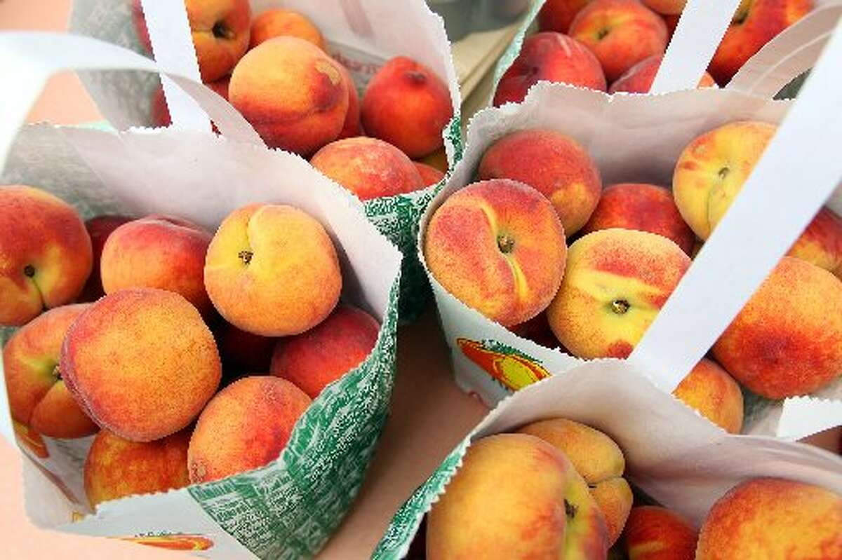 Peaches sold at the Pearl Farmers Market.
