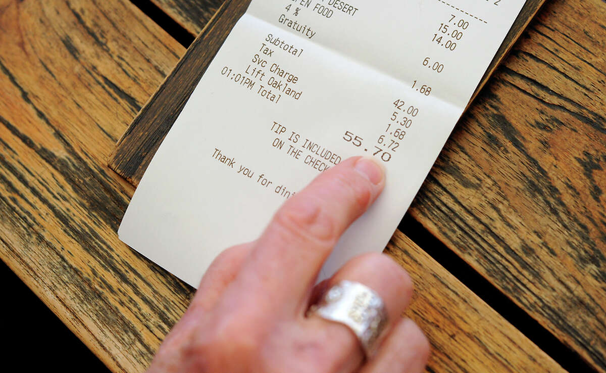In response to an increase in the minimum wage, checks at Bocanova in Oakland now include a 16 percent surcharge and a 4 percent service fee rather than a line for tips.
