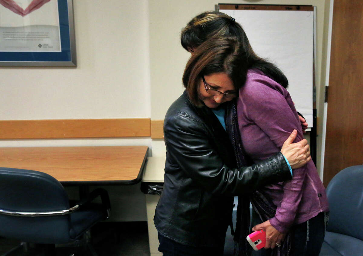 Kidney donor Zully Broussard, left, hugs her longtime friend Pam Nelson after finishing an emotional press conference about the largest single center kidney paired donation chain on the West Coast at California Pacific Medical Center March 4, 2015 in San Francisco.