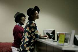 Shanté Wolfe (left) and Tori Sisson wait for their marriage license to be processed in Montgomery, Ala., last month. The state's Supreme Court this week ordered probate judges to uphold the state's ban on same-sex marriages and stop issuing licenses to same-sex couples.