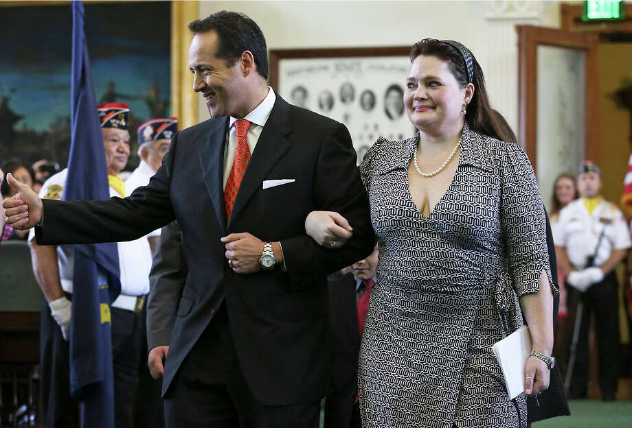 Jose Menendez walks into the Senate with his wife Cehlia Newman-Menendez to be sworn in by Orlando Garcia, U.S. District Judge from San Antonio at a special ceremony in the Senate at the Capitol in Austin on March 4, 2015. Photo: Tom Reel, San Antonio Express-News