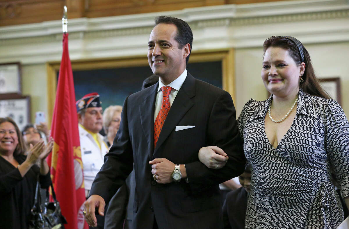 Jose Menendez walks into the Senate with his wife Cehlia Newman-Menendez to be sworn in by Orlando Garcia, U.S. District Judge from San Antonio at a special ceremony in the Senate at the Capitol in Austin on March 4, 2015.