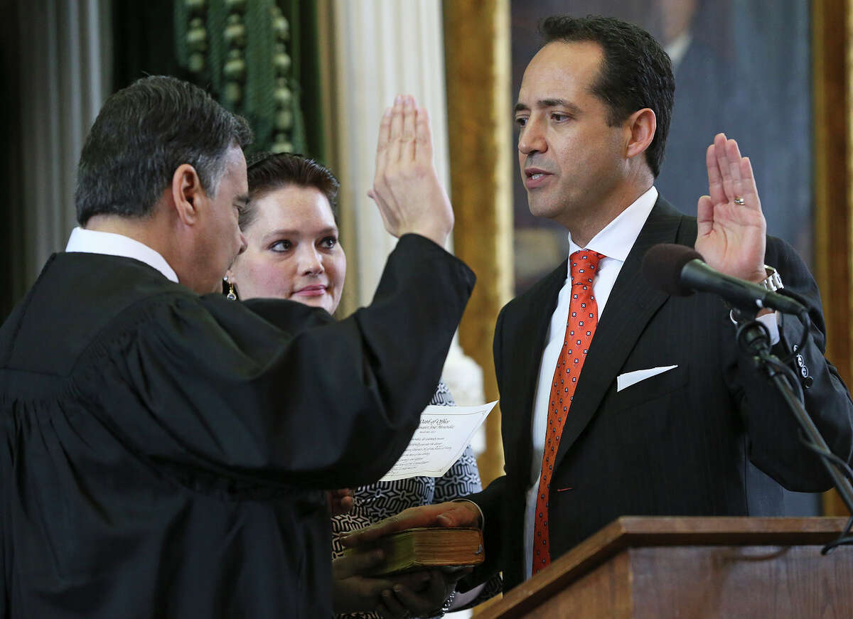 Jose Menendez is sworn in as a Texas Senator by Orlando Garcia, U.S. District Judge from San Antonio at a special ceremony in the Senate at the Capitol in Austin on March 4, 2015.