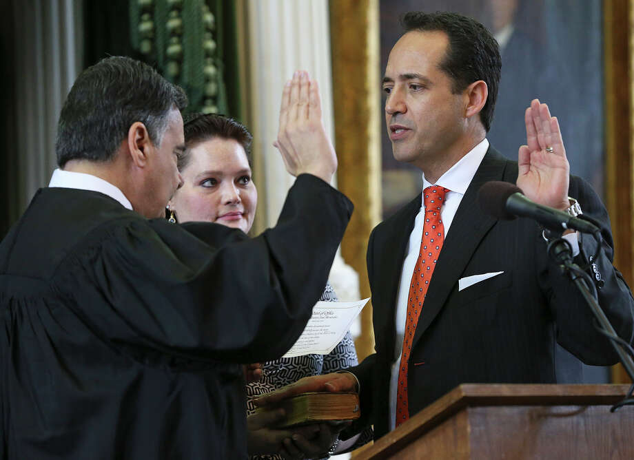Jose Menendez is sworn in  as a Texas Senator by Orlando Garcia, U.S. District Judge from San Antonio at a special ceremony in the Senate at the Capitol in Austin on March 4, 2015. Photo: Tom Reel, San Antonio Express-News
