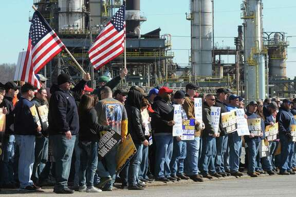 Representatives from the United Steel Workers union rally at the entrance to the Marathon refinery in Catlettsburg, Ky. Saturday Feb. 7, 2015. That strike has now settled, though strikes continue at five other plants, including three in the Houston area. (AP Photo/The Independent, Kevin Goldy)