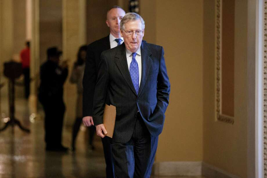 Senate Majority Leader Mitch McConnell, R-Ky., walks to the chamber without enough votes for the GOP-controlled Senate to override President Barack Obama's veto of a bill to construct the Keystone XL pipeline, the first of many confrontations between the Republican-controlled Congress and the White House this year over energy policy, at the Capitol in Washington, Wednesday, March 4, 2015.  The 62-37 vote is expected to be one of many veto showdowns between Republicans and Obama in his final term. Already, the White House has issued more than a dozen veto threats on legislation.   (AP Photo/J. Scott Applewhite) Photo: J. Scott Applewhite, STF / AP