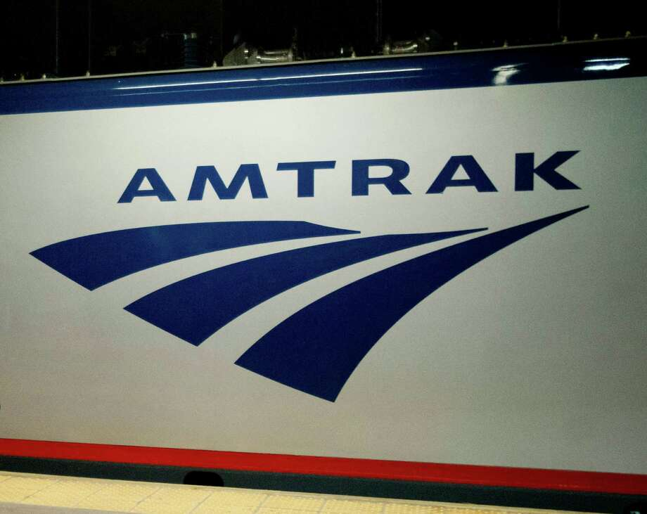 FILE - In this Feb. 6, 2014 file photo, an Amtrak logo is seen on a train at 30th Street Station in Philadelphia. The House has passed a bill that could boost Amtrak service in the popular Northeast Corridor while giving states more authority over the routes they help subsidize. The bill was approved Wednesday by a vote of 316 to 101. It authorizes $7.2 billion over the next four years, keeping Amtrak subsidies nearly the same as current spending levels. Amtrak supporters had urged an increase in funds to address a backlog of infrastructure projects.  (AP Photo/Matt Rourke, File) ORG XMIT: WX107 Photo: Matt Rourke / AP