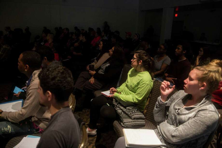 Students and community members listen as Professor Allen Lee Hamilton gives a presentation about the Alamo and its history at St. Philip's College in San Antonio, TX on Wednesday, March 4, 2015. Photo: Carolyn Van Houten, Staff / San Antonio Express-News / 2015 San Antonio Express-News