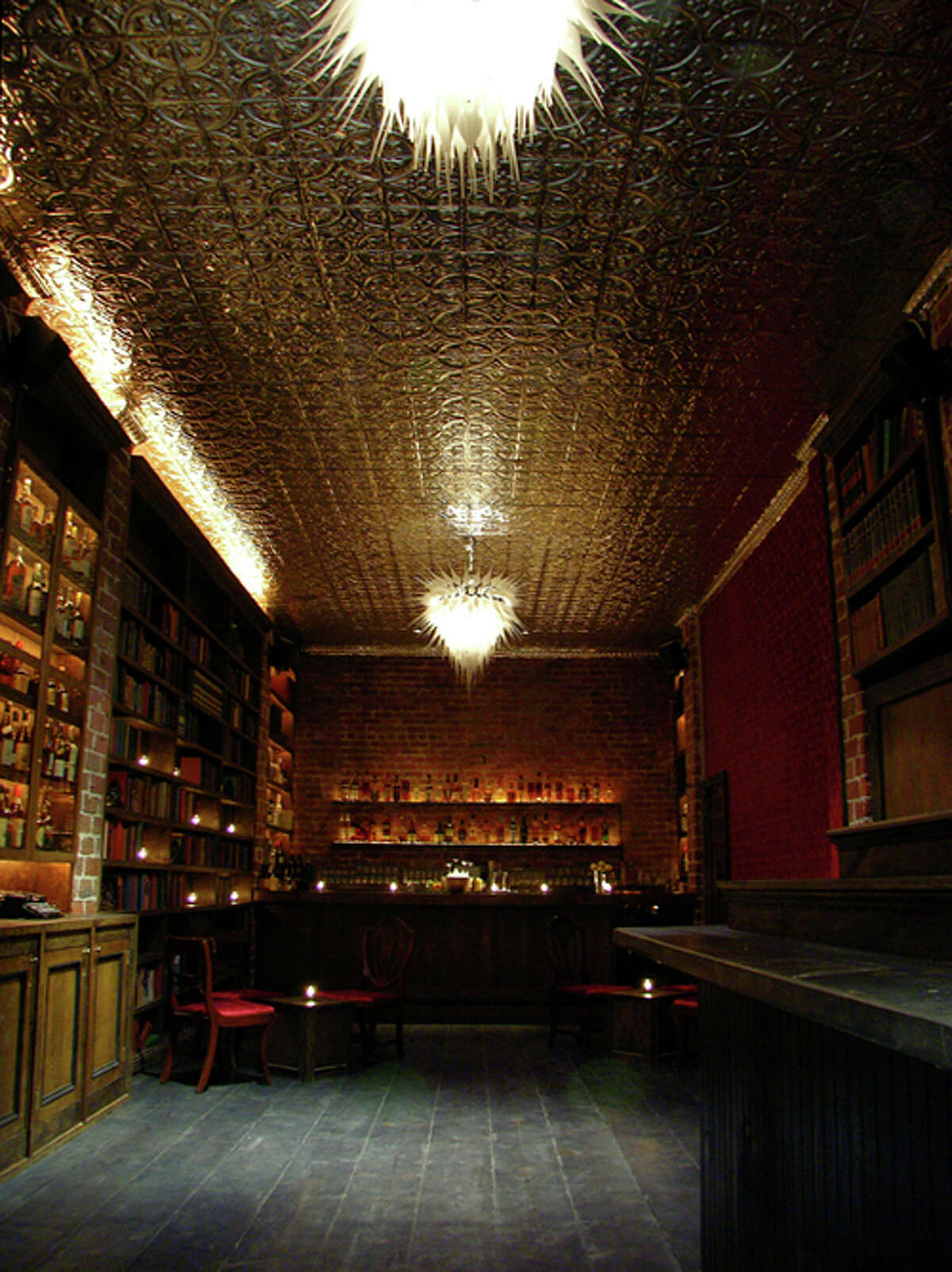 Bourbon & Branch in San Francisco While the names have changed, the conventions of 501 Jones St. haven't; a bar has been operating here since 1867. During Prohibition it was under the guise of JJ Russell Cigar Shop and boasted all the secret entrances and exit tunnels one would hope for in an original speakeasy. The aura of secrecy from that era remains. You'll have to make a reservation to get a password to enter and be escorted through some of those same secret doors. The '20s-inspired cocktail menu changes regularly, since many of the ingredients are sourced locally, with offerings like gimlets, fizzes, and, of course, lots of gin. Per the house rules, there are no cell phones or photography allowed.