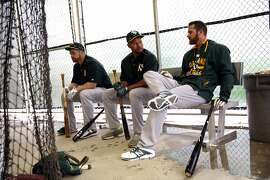Oakland Athletics' Stephen Vogt, Coco Crisp and Craig Gentry wait to hit during Spring Training at Fitch Park in Mesa, Arizona, on Monday, March 2, 2015.