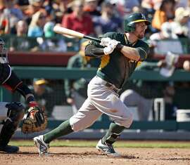 Oakland Athletics' Eric Sogard doubles in 4th inning against San Francisco Giants in Spring Training Cactus League game at Scottsdale Stadium in Scottsdale, Arizona, on Wednesday, March 4, 2015.
