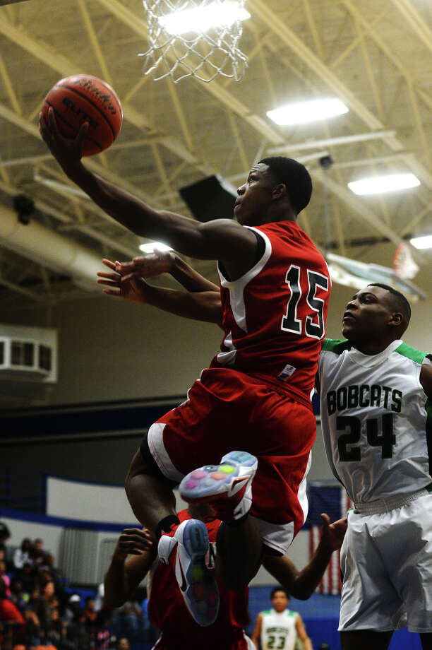 Kountze's Grayland Arnold, No. 15, takes the ball up for a point during Tuesday's game against Hempstead. The Kountze Lions played the Hempstead Bobcats at Barbers Hill High School on Tuesday in the Region 3 3A regional quarterfinal playoffs. Photo taken Tuesday 3/3/15 Jake Daniels/The Enterprise Photo: Jake Daniels / ©2015 The Beaumont Enterprise/Jake Daniels