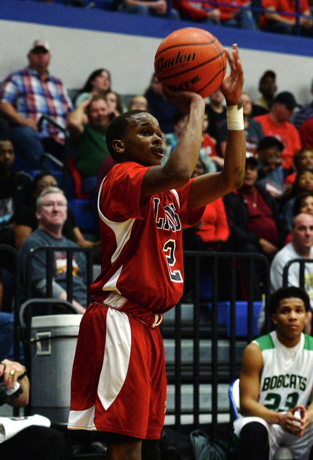 Kountze's Teran Stanford, No. 2, goes up for a three-point shot against Hempstead on Tuesday. The Kountze Lions played the Hempstead Bobcats at Barbers Hill High School on Tuesday in the Region 3 3A regional quarterfinal playoffs.  Photo taken Tuesday 3/3/15  Jake Daniels/The Enterprise Photo: Jake Daniels / ©2015 The Beaumont Enterprise/Jake Daniels