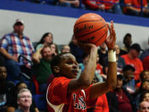 Kountze's Teran Stanford, No. 2, goes up for a three-point shot against Hempstead on Tuesday. The Kountze Lions played the Hempstead Bobcats at Barbers Hill High School on Tuesday in the Region 3 3A regional quarterfinal playoffs.  Photo taken Tuesday 3/3/15  Jake Daniels/The Enterprise