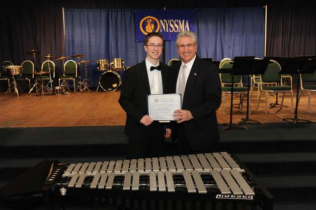 Assemblyman Jim Tedisco presents an Assembly citation to Brian Halliday, a Shenenedehowa High School junior, who was at the Capitol for High School Music Arts Day. He performed at the Empire State Plaza as a member of the All-State Jazz Ensemble. (Adam Kramer) / NYGOP PHOTO
