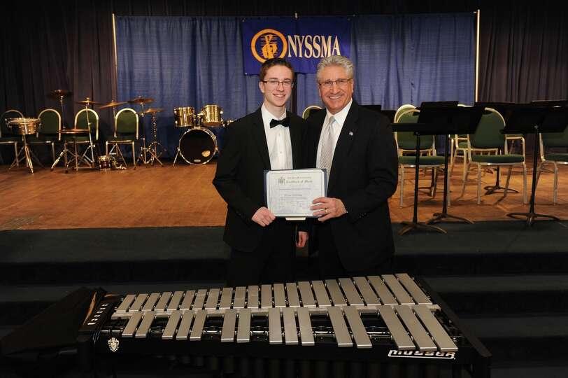 Assemblyman Jim Tedisco presents an Assembly citation to Brian Halliday, a Shenenedehowa High School