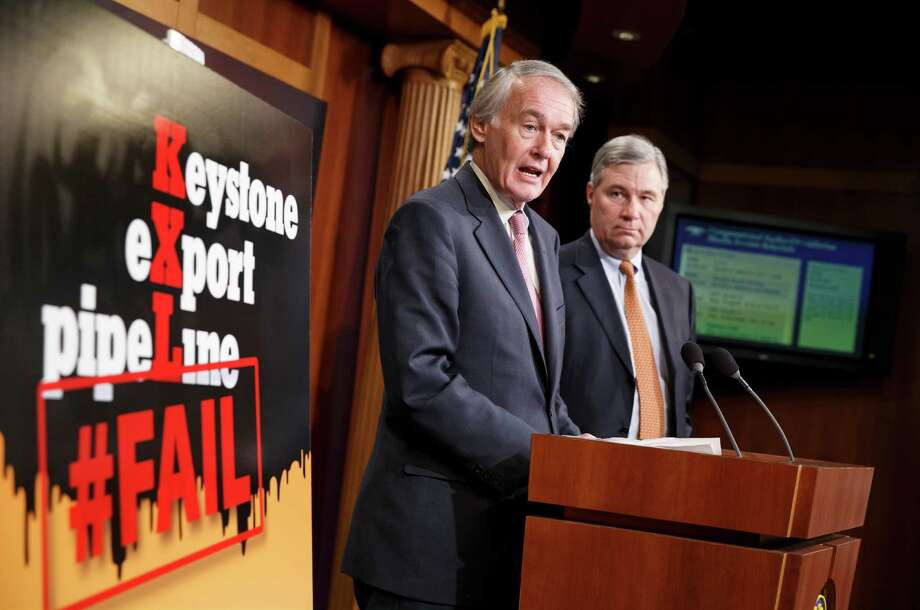 """Sen. Ed Markey, D-Mass., accompanied by Sen. Sheldon Whitehouse, D-R.I., speaks to reporters after the Senate vote. """"This pipeline is not in America's national interest,"""" Markey said. """"It is not in the best interests of our climate."""" Photo: J. Scott Applewhite /Associated Press / AP"""
