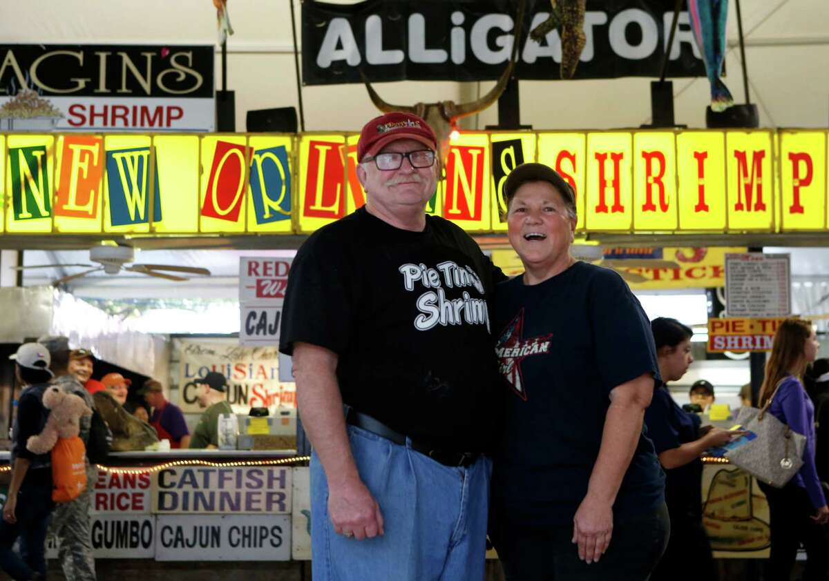 Shirley and Jim Rewerts, of Beaumont, pose for a photo at their booth, the