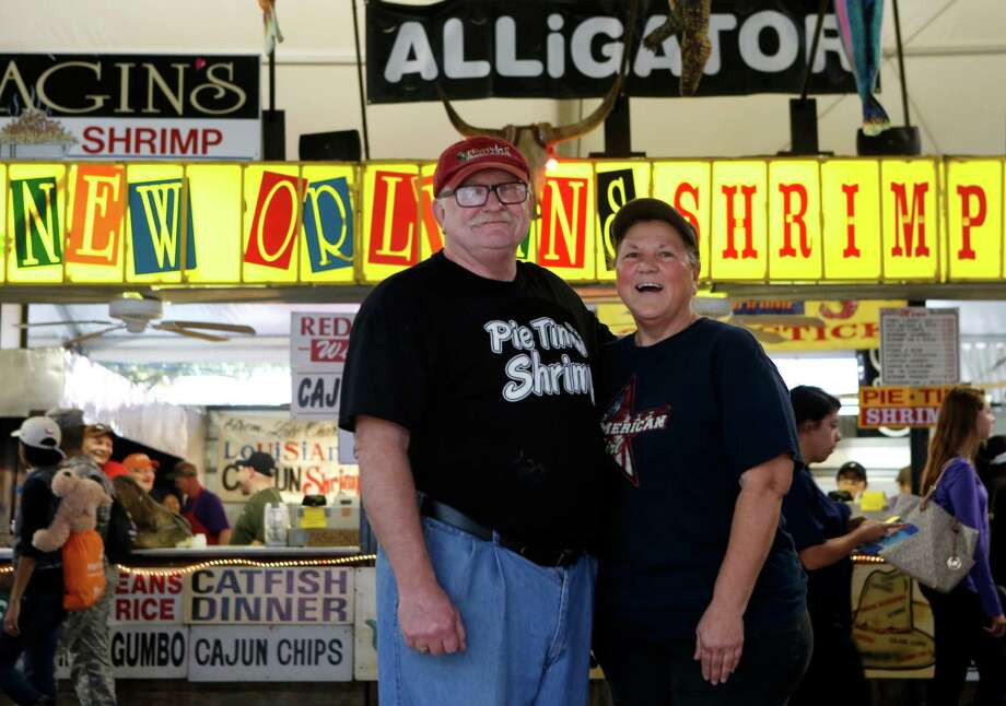 """Shirley and Jim Rewerts, of Beaumont, operate the Cajun food-inspired """"New Orleans Shrimp Hotel"""" stand at the Houston Livestock Show and Rodeo.  Photo: Jon Shapley, Staff / © 2015 Houston Chronicle"""